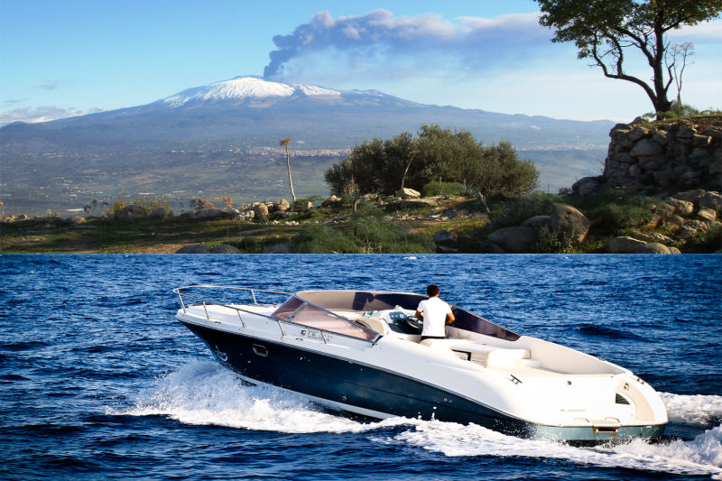 Sicilyspot at the Etna and sea with powerboat