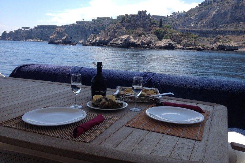 Sicilyspot romantic dinner on board at the Taormina bays